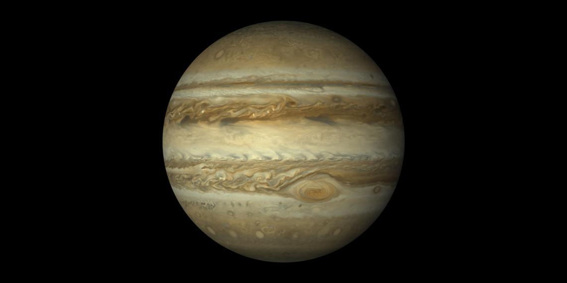 Юпитер. Вижда се голямото червено петно, намиращо се на 22° южно от екватора на планетата.